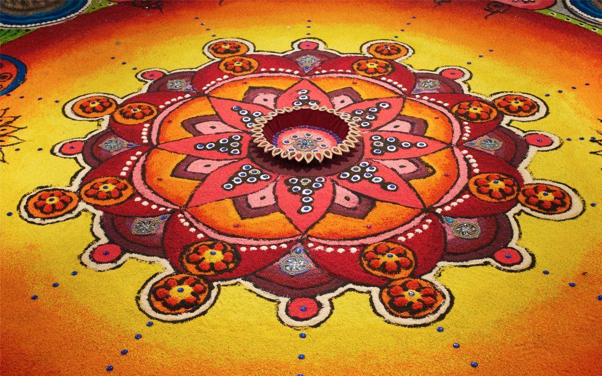 Deepak s barevným rangoli